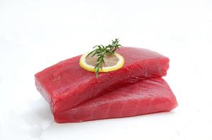 stock-photo-fresh-tuna-fish-steak-on-a-white-background-737686219.jpg